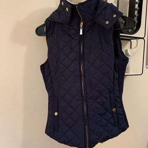 Blue puffy vest with hood